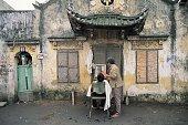 Man getting haircut in Hanoi