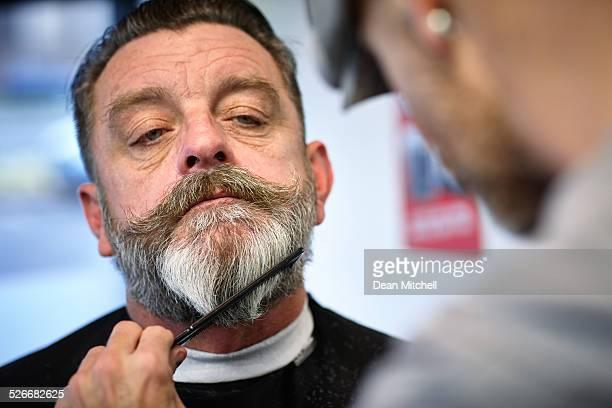 Man getting his beard trimmed