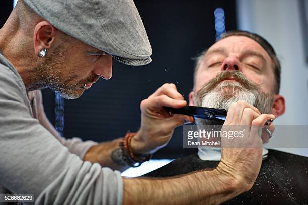 Man getting his beard trimmed