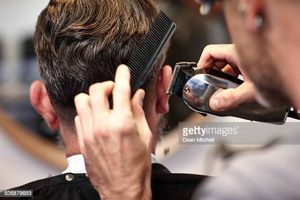 Man getting his hair cut at salon