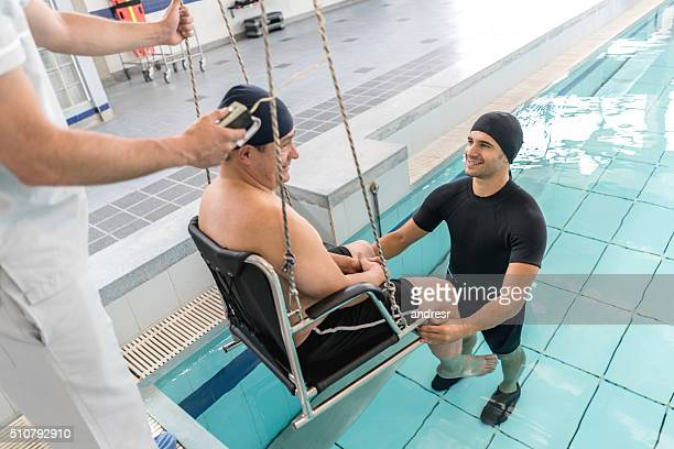 Man getting in the pool for his physical therapy