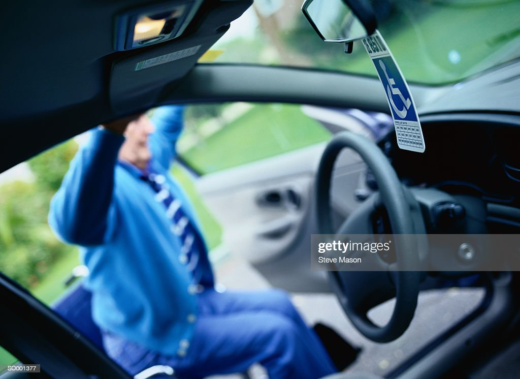 Man Getting Into Car