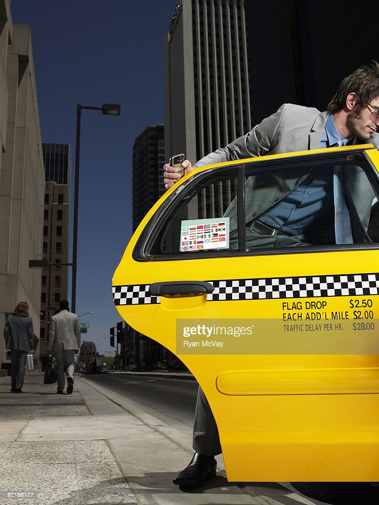 man getting into taxi : Stock Photo