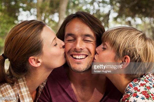 man getting kissed