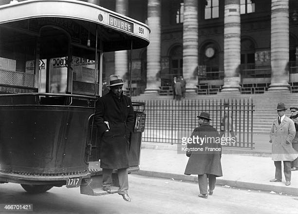 Man getting off the bus in front of the Paris Stock Exchange in May 1929 in Paris France