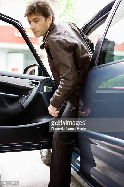 Man getting out of car