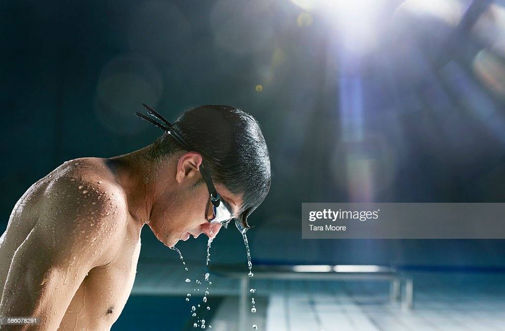 man getting out of pool