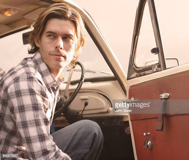 man getting out of vintage car