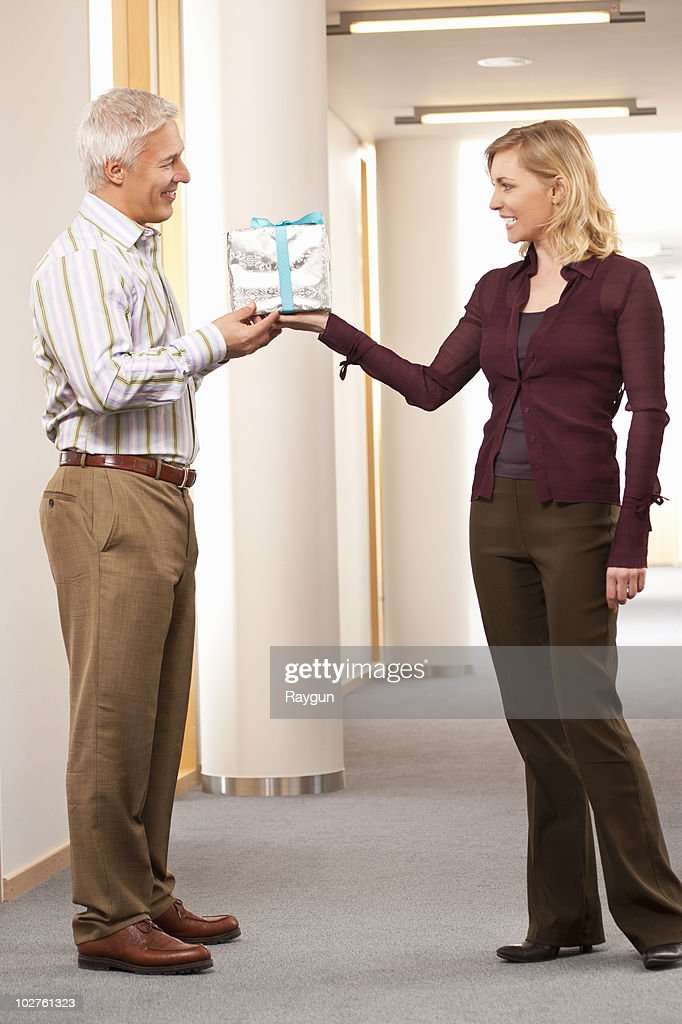 Man getting present from employee : Stock Photo
