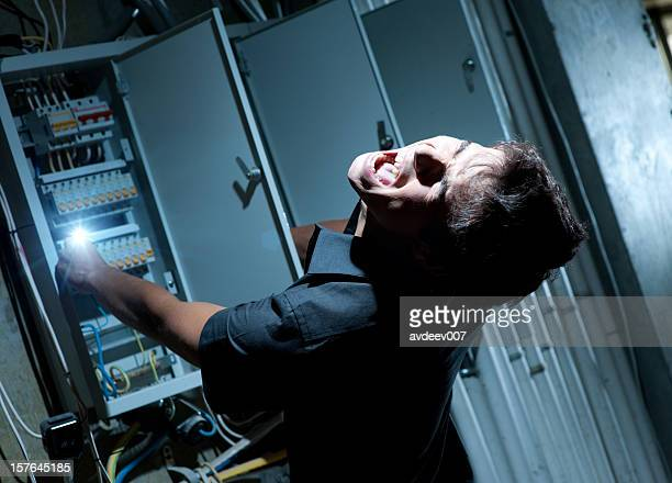 Man getting shocked by electricity on a breaker