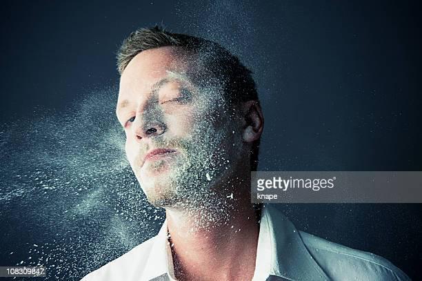 Man getting splashed in flour