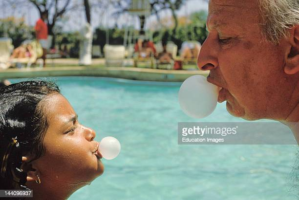 Man Girl Blowing Bubble Gum Bubbles Together