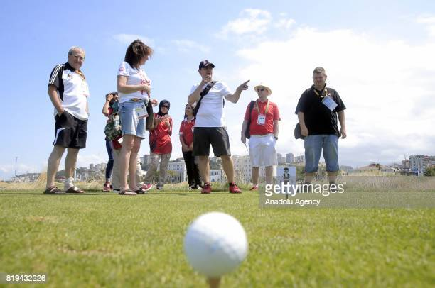 A man gives a briefing on a golf field during a meeting for Turkish and foreign media members ahead of the golf games within the 23rd Summer...