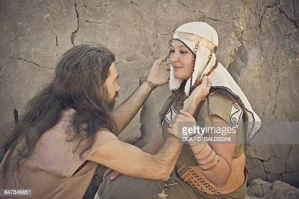 Man giving a necklace to a woman Illyrian civilisation mid3rd century BC Historical reenactment