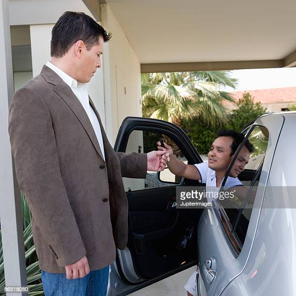 Man giving keys to valet