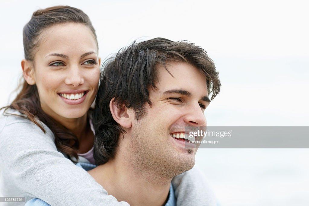 Man giving woman a piggy back ride : Stock Photo