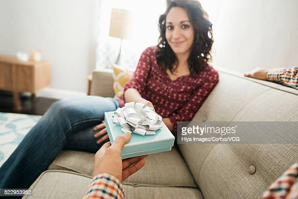 Man giving woman gift box