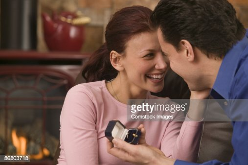 Man giving woman ring : Stock Photo