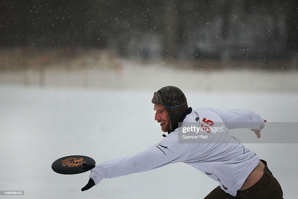 A man goes for a catch of a frisbee during a game of Goaltimate in Prospect Park during a snow storm on December 14, 2013 in the Brooklyn borough of New York City. Much of the Northeast was hit by a storm stretching over 1,000 miles that could result in at least a foot of snow on parts of New England.