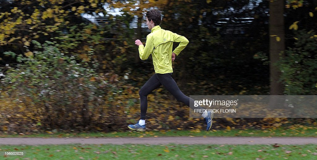 A man goes jogging at the Orangerie's park in Strasbourg, eastern France, on November 15, 2012. The city of Strasbourg is experimenting a 'sports on medical prescription' health programme, for people suffering from cardiac disorders. AFP PHOTO/FREDERICK FLORIN
