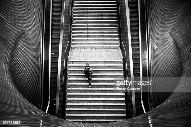 Image has been converted to black and white BERLIN GERMANY AUGUST 17 A man goes upstairs from an underpass on August 17 2016 in Berlin Germany