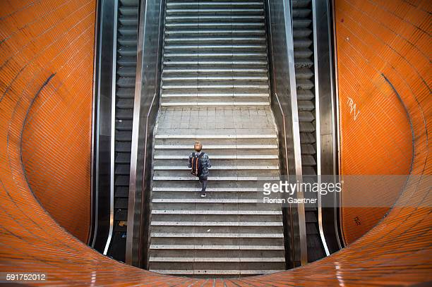 A man goes upstairs from an underpass on August 17 2016 in Berlin Germany
