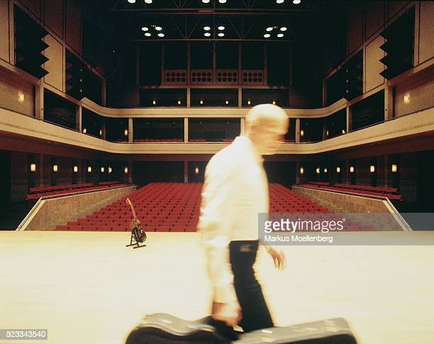 Man going away from stage