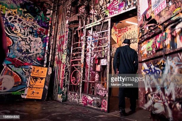 Man going through spray painted doorway