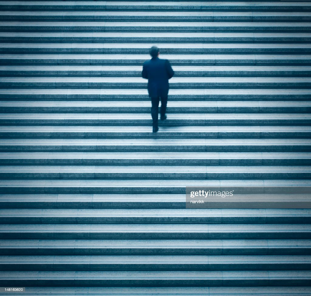 Man going up on the stairs : Stock Photo