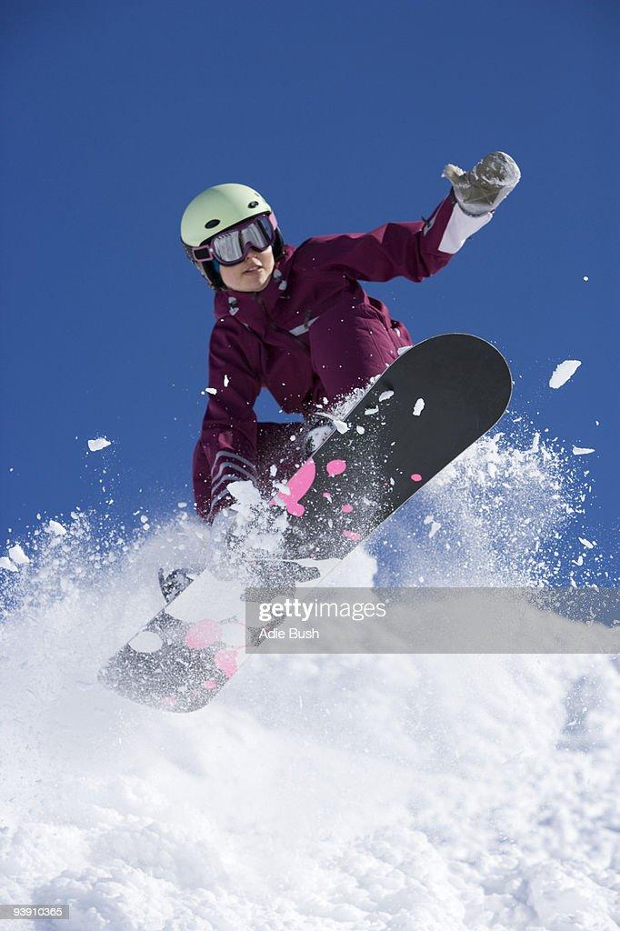 Man grabbing her board mid air.