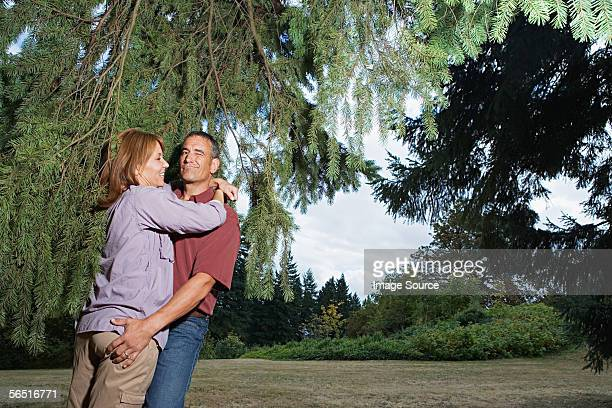 Man grabbing wife's bottom in the woods