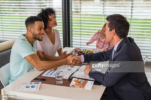 Man greeting male financial advisor