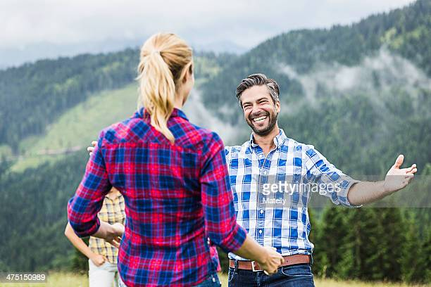 Man greeting woman with open arms, Tirol, Austria