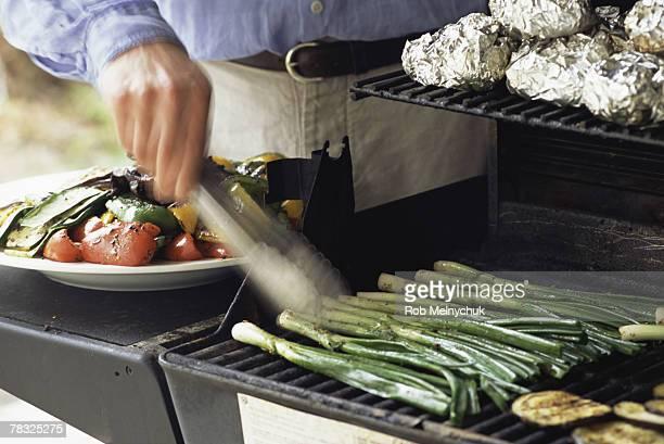 Man grilling vegetables