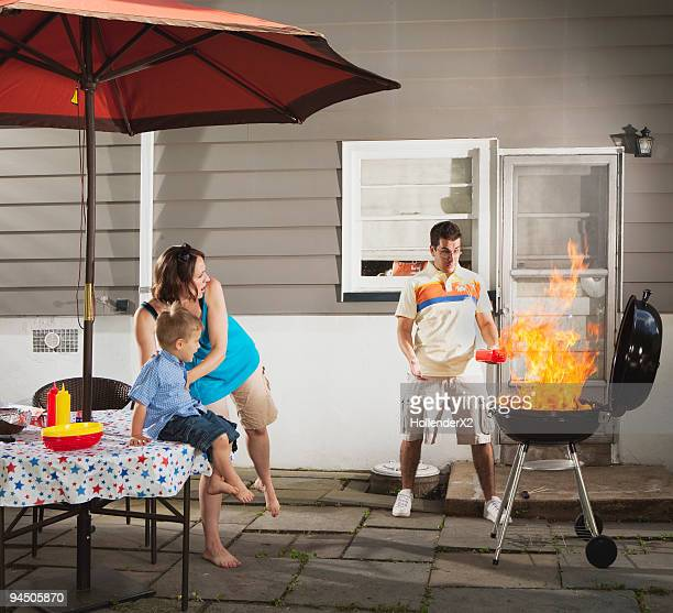 man grilling with huge flame