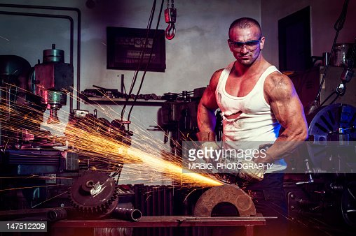 Man Grinding in workshop : Stock Photo