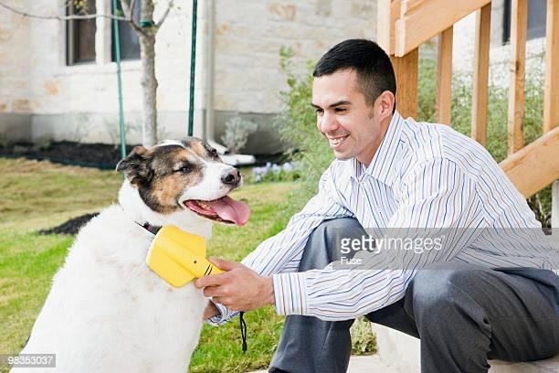 Man grooming his dog