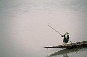 A man guides his pirogue (dugout canoe) along the Niger River at Mopti.