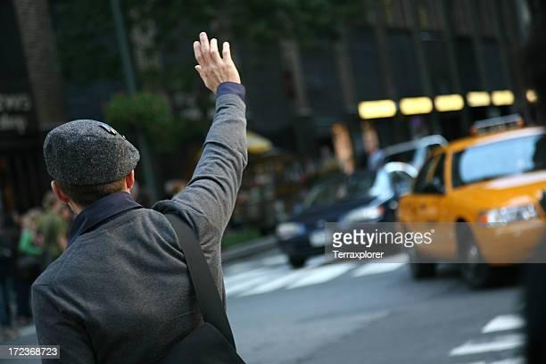 Man Hailing Cab From Street