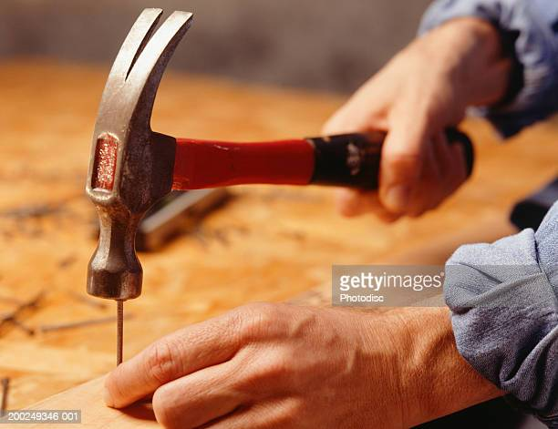 Man hammering nail, (Close-up)