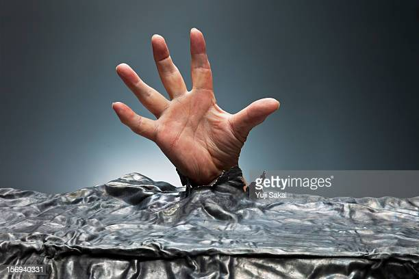 man hand  coming out from lead