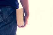 Man hand holding a bible isolated. Vintage color. This has clipping path.