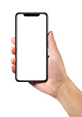 Man hand holding the black smartphone with blank screen and modern frame less design isolated on white