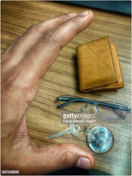 Man Hand Reaching Towards House Key And Wallet