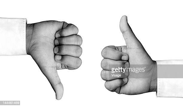 Man hand showing thumbs up and thumbs down