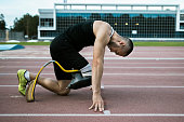 Man handicap athlete preparing to start running