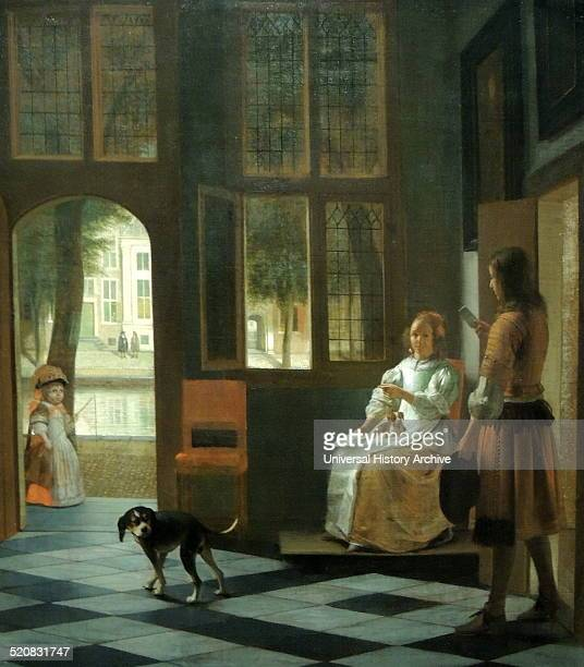 Man handing a letter to a woman in the entrance hall of a house by Pieter de Hooch The door and window in the hall are open helping to link the...