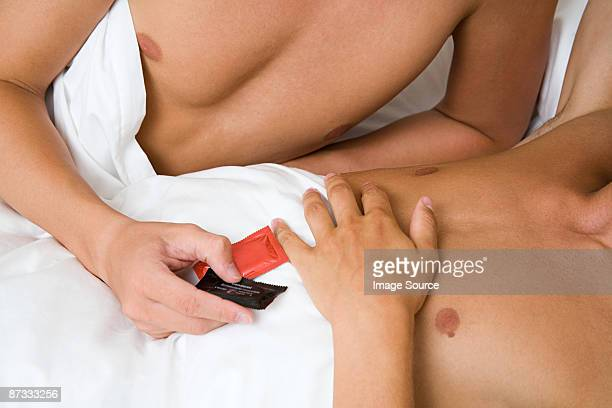 A man handing condoms to his partner