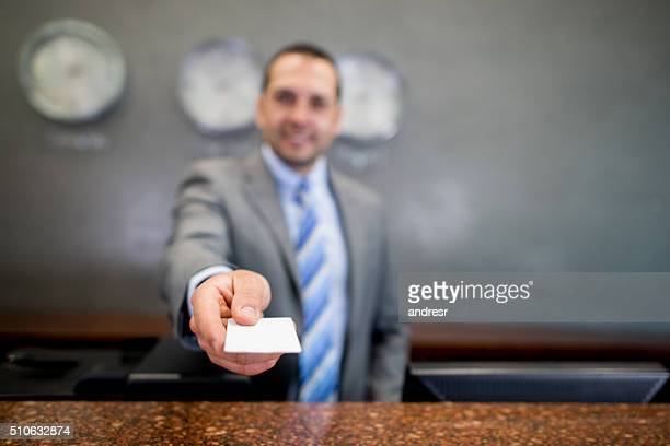 Man handling card key at a hotel