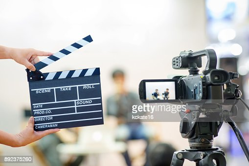 Man hands holding movie clapper. : Stock Photo